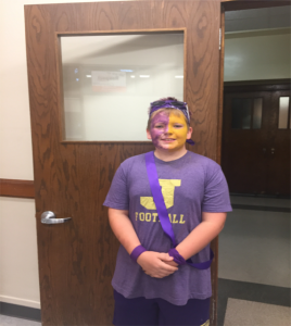 student dressed for purple & gold day