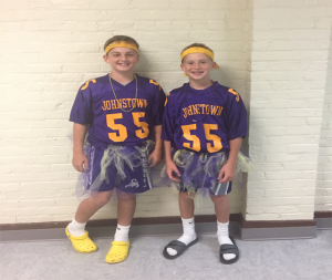 two students dressed for purple & gold day