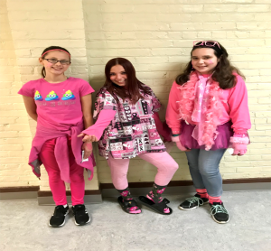 three students dressed in pink