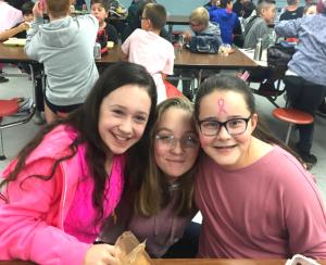 three girls in pink
