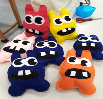 a collection of pillows sewn by students