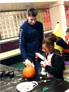 JHS student helps Glebe student decorate