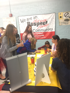 students line up at display table