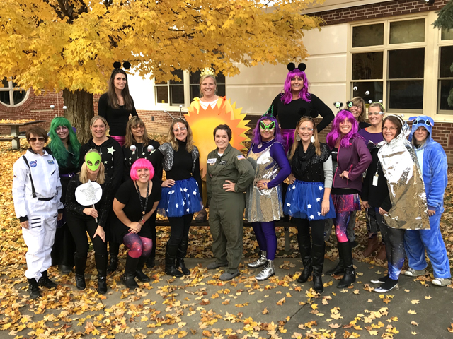 Principal Cory Cotter and Pleasant staff members in costume