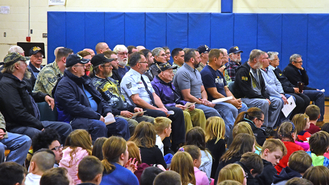 students and veterans gathered in Warren Street gym for assembly
