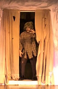 zombie appears from behind curtains