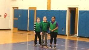 three students standing together