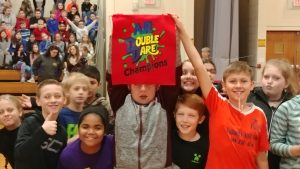 students holding double dare flag
