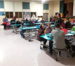 families in cafeteria for cookies & cooca
