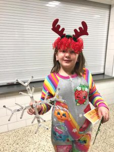 student with reindeer antlers on head