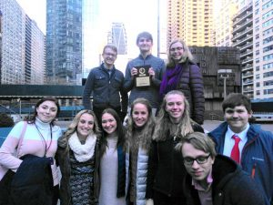 students in front of Manhattan skyline