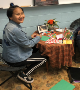 student working on crafts