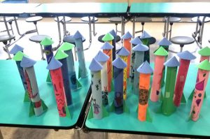 completed colored paper rocket ships
