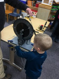 child engaged in STEAM activity