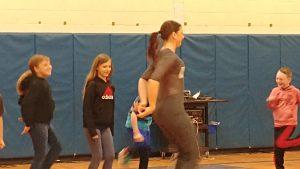 performer teaching dance moves