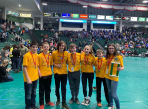 Knox students on Energetic Engineers Team pose with their trophy at NYS Odyssey of the Mind Finals