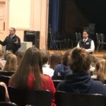 students listening to Mr. Detraglia