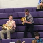 brass students on JHS gym bleachers