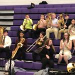 brass & woodwinds students on JHS bleachers