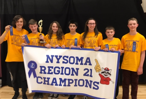 Seven students holding NYSOMA Region 21 Champions banner