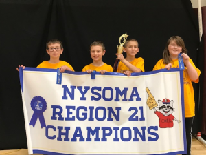 four students holding NYSOMA Region 21 Champions banner