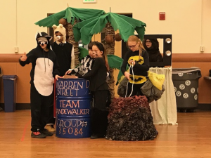 kids in costumes, with props