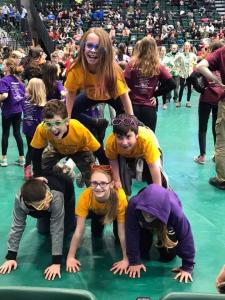 students forming a human pyramid