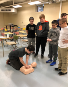 student practicing on cpr dummy