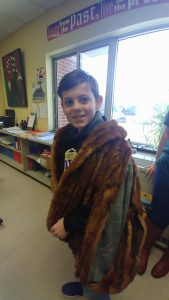 student draped in a fur pelt