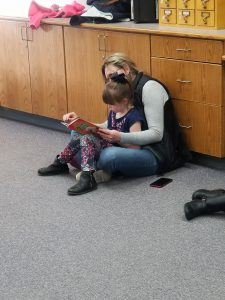 adult and child reading together