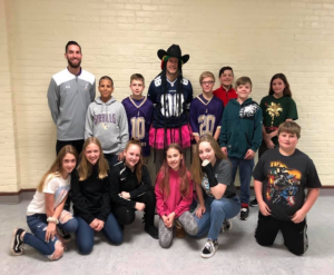 "students surround principal dressed as ""Dancing Dallas Cowboy"""
