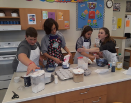 more students mixing batter