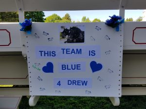 "sign reading ""This Team is Blue for Drew"""