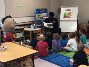 another view of Mohawks player reading to students
