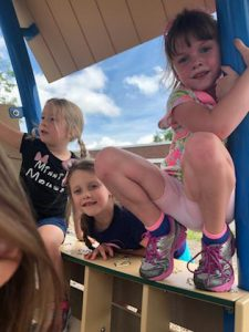kids on playground equipment