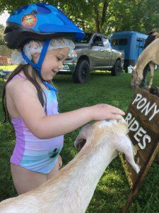 girl petting a goat