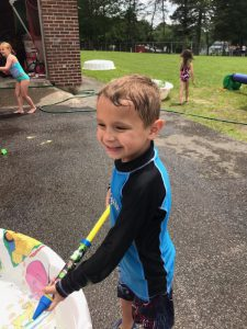 boy by a kiddie pool