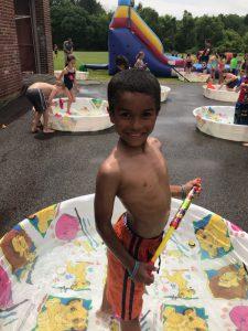 boy standing in kiddie pool