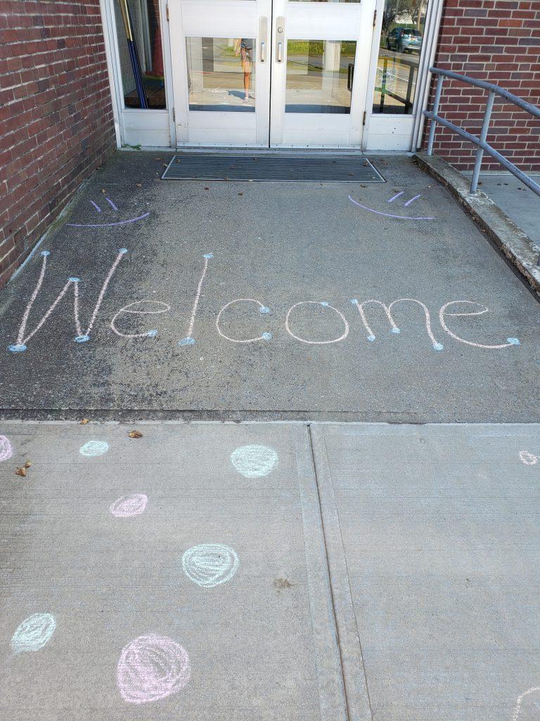 """""""welcome"""" written in chalk"""