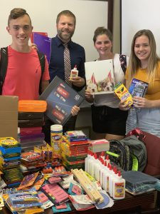 students hold some of the donated supplies