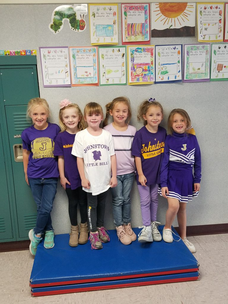 six elementary students in Johnstown Purple & Gold clothing