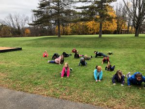 from another angle - students on lawn at Pleasant doing push ups