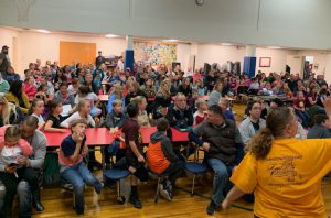 large crowd of students and parents gathered to hear Odyssey kick-off presentation