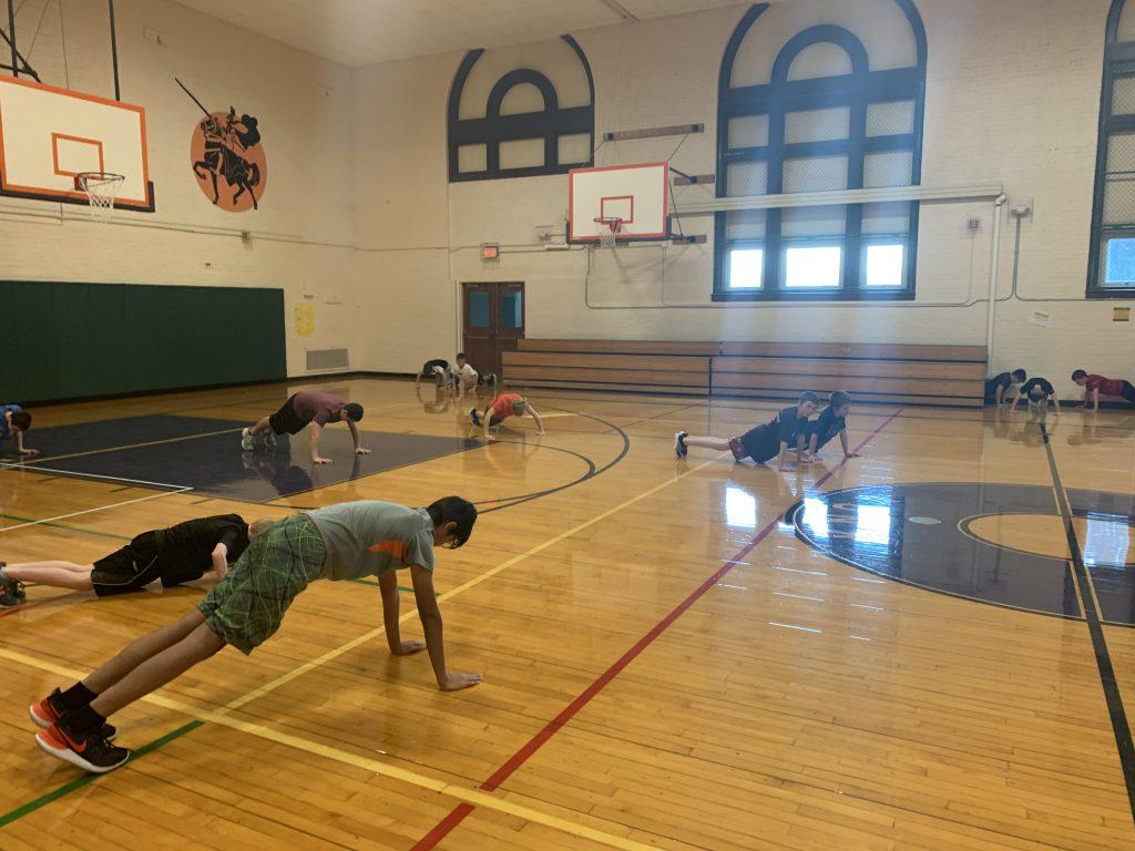 third group of Knox students doing push ups