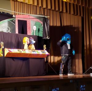 puppets and a character on the stage