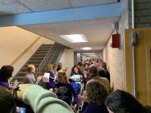 team moving through hallway
