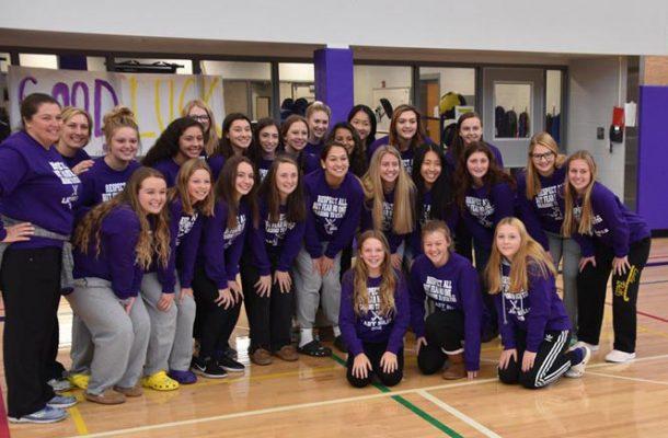 Lady BIlls Field Hockey team posing in gym