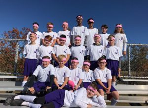 group of people wearing pink headbands