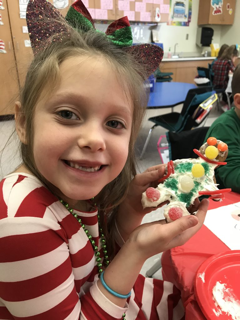 student holding decorated cookie