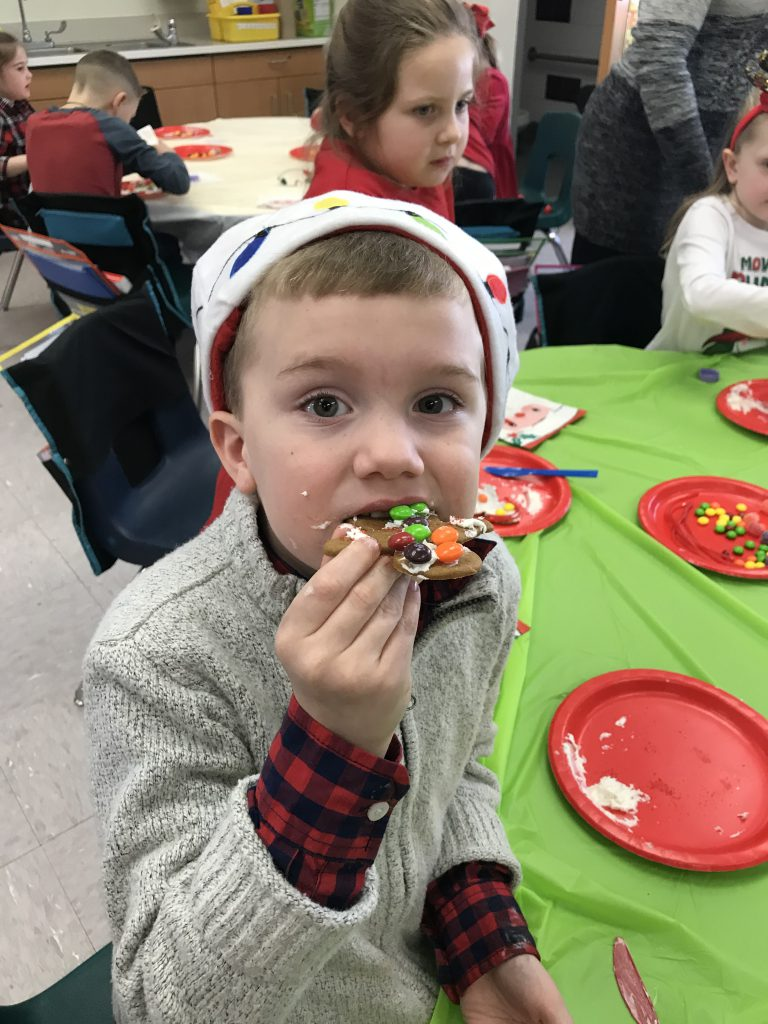 student eating decorated cookie